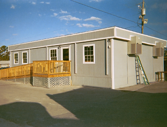 Double Wide Modular sales office with site built landing and ramp with handrails. Modular and trailer rentals in the Houston Texas Metro Area, South East Texas and Louisiana.