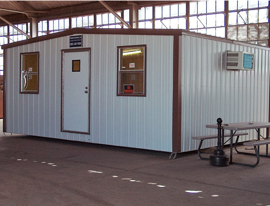 Implant portable/skid building for breakroom inside warehouse provided by Precision Structures serving Houston Texas metro area.